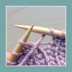Between a knit and a purl stitch